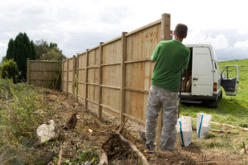 Fencing Contractor working on a fence installation