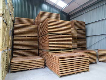 Traditional Waney Lap Fence Panels in our Warehouse Storage Facility